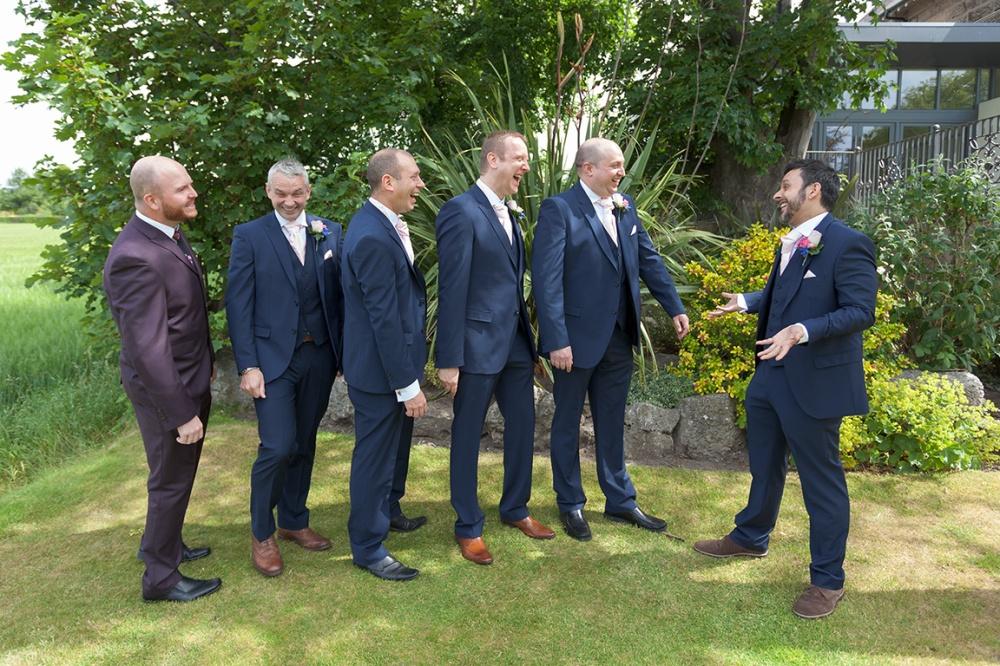 groom and groomsmen having fun the west tower hotel