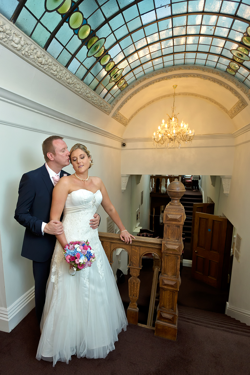 Bride & Groom on the Stairs The West Tower Hotel stain glass in roof